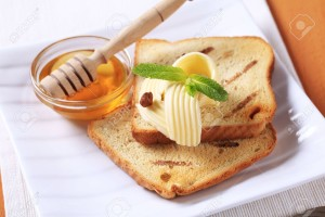7437505-Breakfast-Toasted-bread-butter-and-honey-Stock-Photo-toast